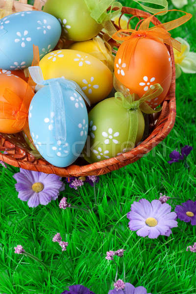 color easter eggs in basket on the green grass Stock photo © artjazz