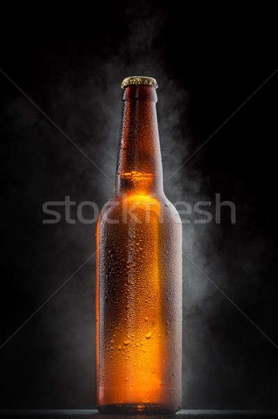 Hideg sörösüveg cseppek fagy fekete víz Stock fotó © artjazz