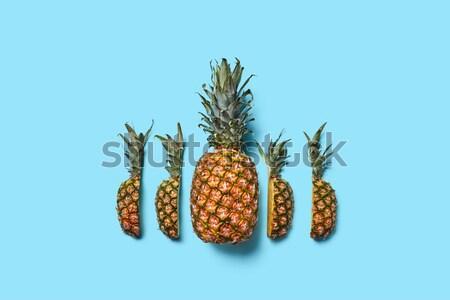 Taze ananas yalıtılmış mavi turuncu üst Stok fotoğraf © artjazz