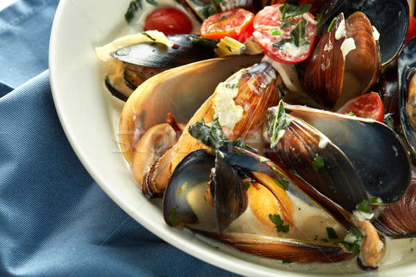 Plate of mussels in garlic sauce Stock photo © artjazz