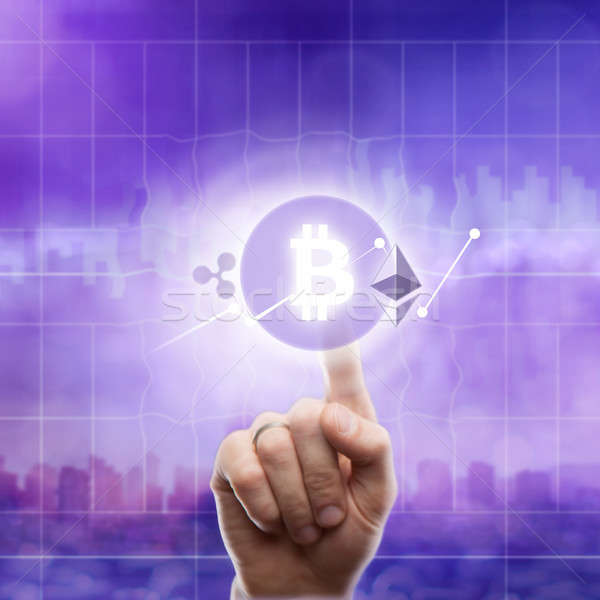 Icons bitcoin ripple, ethereum on an ultra purple background of the city. The hand touches the bitco Stock photo © artjazz