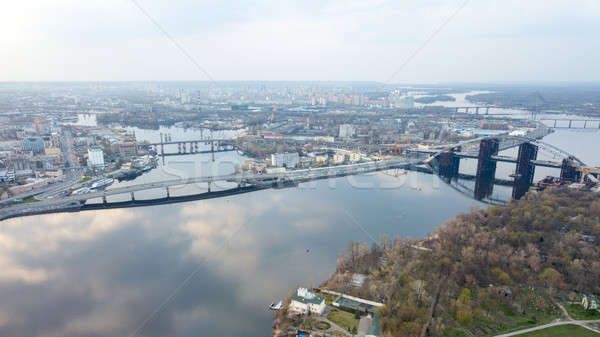 Aerial view of the Kiev (Kyiv) city, Ukraine. Dnieper river with bridges. Obolon district in the bac Stock photo © artjazz