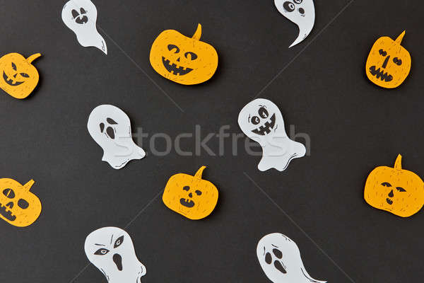 Creative colorful handmade pattern with paper horrible smiling spirits and ghosts and laughing pumpk Stock photo © artjazz