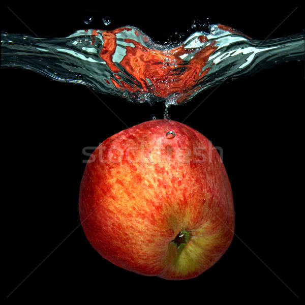 green apple dropped into water with splash isolated on black Stock photo © artjazz