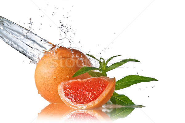 Water splash on grapefruit with mint isolated on white  Stock photo © artjazz