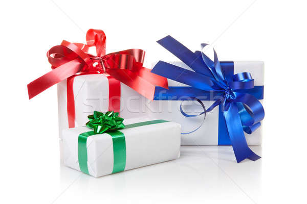 Holiday gifts with color ribbons isolated on white Stock photo © artjazz