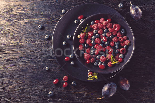 Stock photo: summer fruit on black wooden table