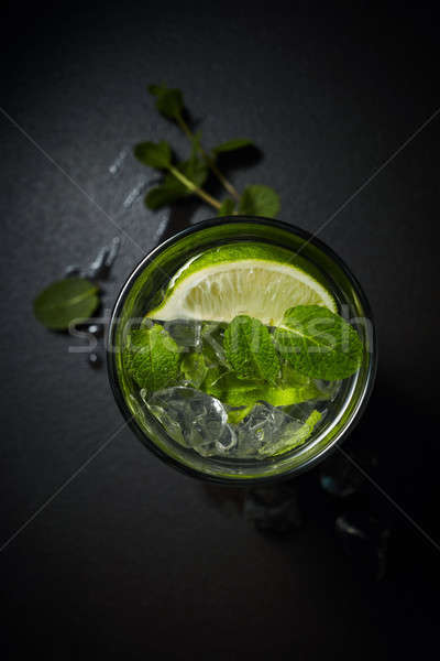 Lemonade or citrus cocktail with ice and mint overhead shot Stock photo © artjazz