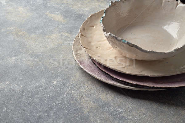 Traditional souvenir porcelain handmade colorful plate and bowl on a gray concrete background. Stock photo © artjazz