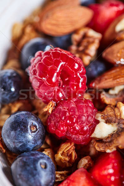 Mix of berries, nuts, oatmeal, granola and honey close-up. Ingre Stock photo © artjazz