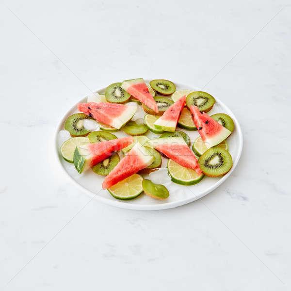 Vers vruchten kom stukken kalk watermeloen Stockfoto © artjazz