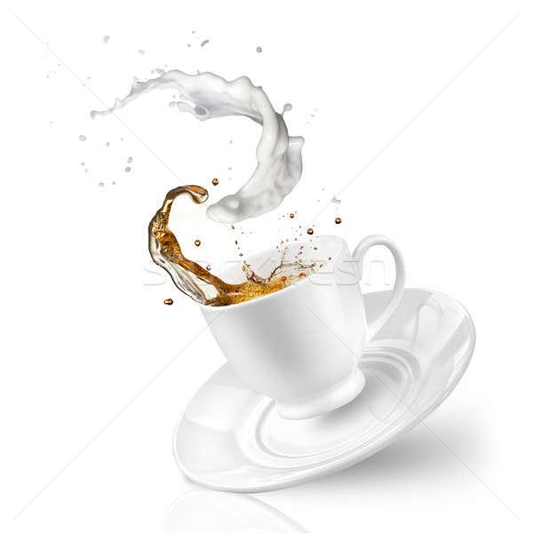Splash of tea with milk in the falling cup isolated on white Stock photo © artjazz
