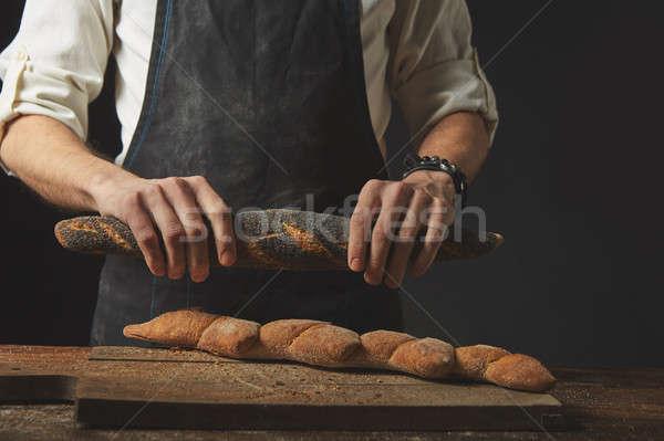 hands men break the baguette Stock photo © artjazz