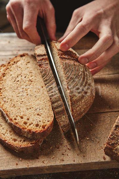 Male hands slicing homemade bread Stock photo © artjazz