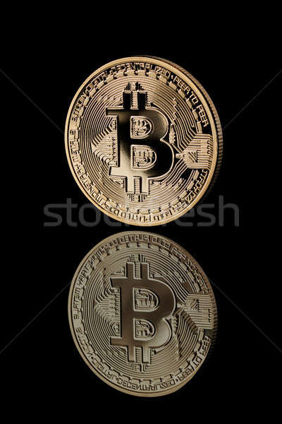 Gold Bitcoin Coin on black background. Stock photo © artjazz