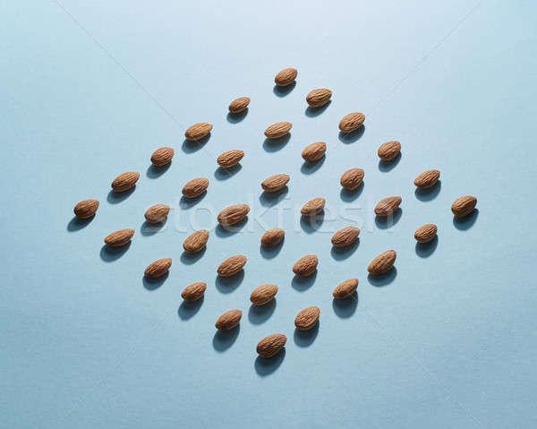 Figured pattern of almonds on a blue background Stock photo © artjazz