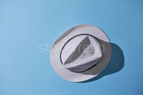 Szary mężczyzna hat odizolowany niebieski elegancki Zdjęcia stock © artjazz