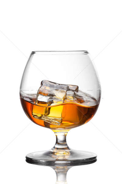 Splash of whiskey with ice in glass isolated on white background Stock photo © artjazz