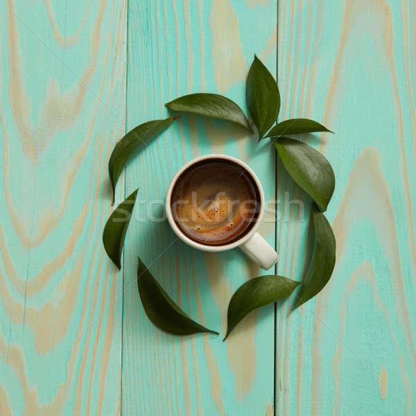 カップ ブラックコーヒー 緑の葉 孤立した 青 花 ストックフォト © artjazz