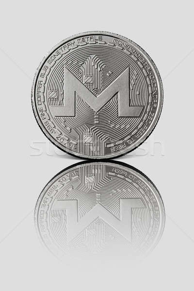Silver coin monero on a white glossy background Stock photo © artjazz