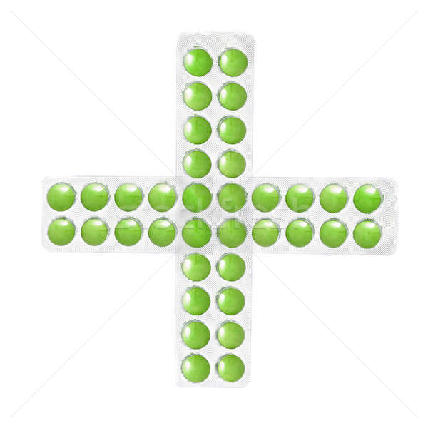 cross from packs of green tablets isolated on white Stock photo © artjazz