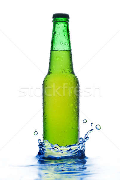 Green beer bottle with water drops and splash isolated on white Stock photo © artjazz