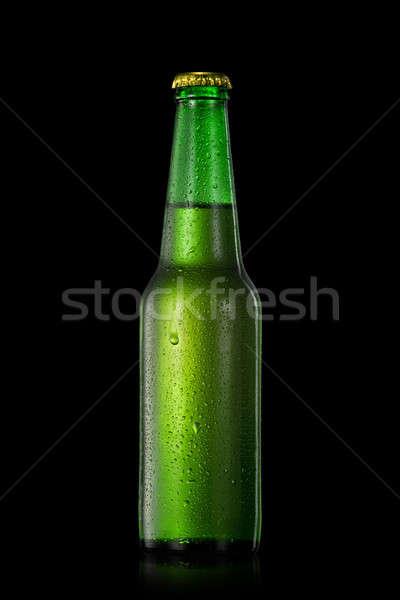 Sörösüveg vízcseppek izolált fekete zöld buli Stock fotó © artjazz