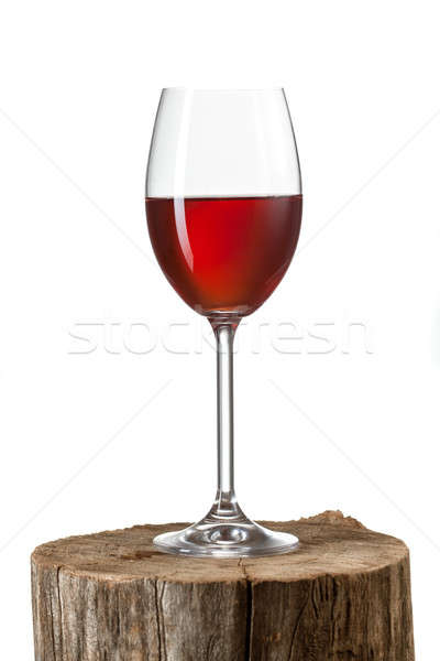 Glass of red wine on stump isolated on white Stock photo © artjazz