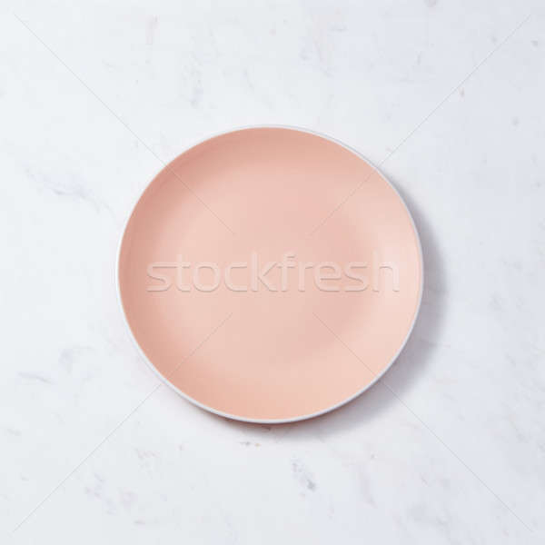 Traditional decorative handcrafted clay dish, covered with glazed on a gray concrete background. Fla Stock photo © artjazz