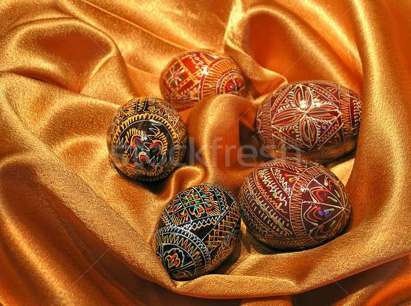 easter eggs on satin Stock photo © artjazz