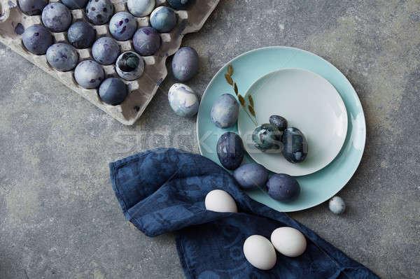 Húsvéti tojások kék ruha gyönyörű ünnep húsvét Stock fotó © artjazz