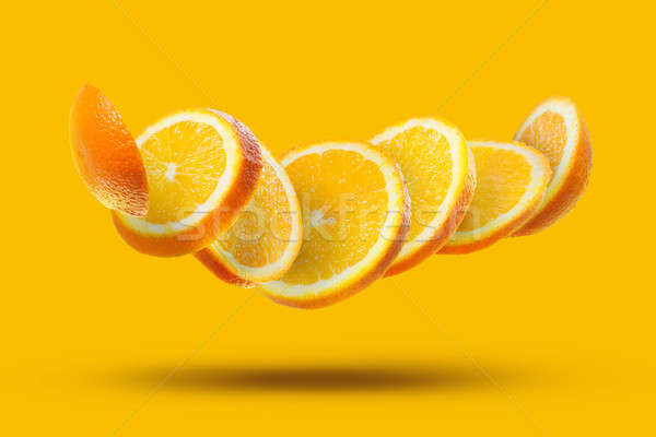 flying orange slices isolated Stock photo © artjazz