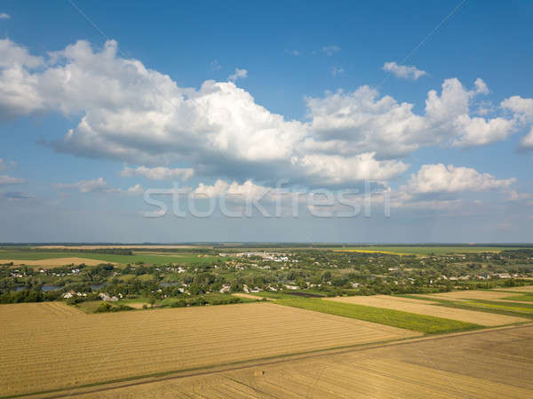 Summer countryside landscape with agricultural fields with crops and after harvesting on a backgroun Stock photo © artjazz
