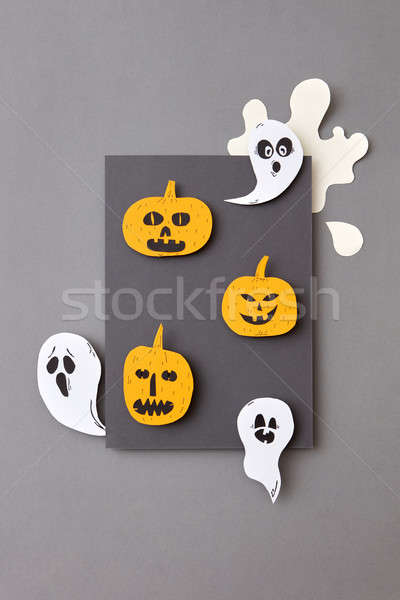 Happy Halloween. Square frame of flying floating, ghosts spirits and smiling yellow pumpkins on a gr Stock photo © artjazz
