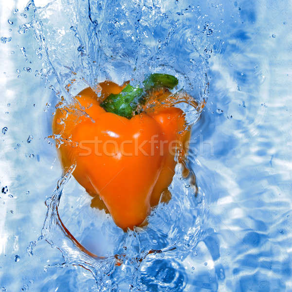 Yellow pepper dropped into water with bubbles Stock photo © artjazz