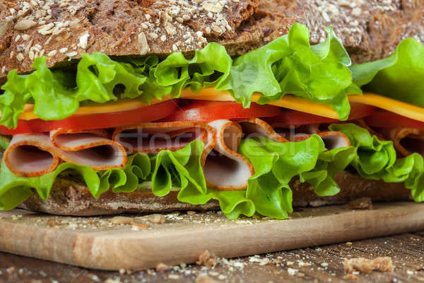 Sandwich on the wooden table Stock photo © artjazz