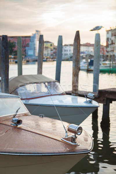 riva boat parked on the canal in Venice Stock photo © artjazz