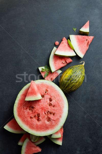 Szelet görögdinnye izolált fekete víz gyümölcs Stock fotó © artjazz
