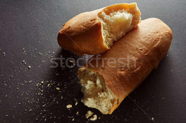 halved bread roll with crumbs Stock photo © artjazz