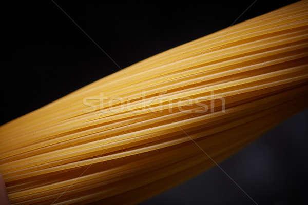 Macro foto giallo spaghetti nero lungo Foto d'archivio © artjazz