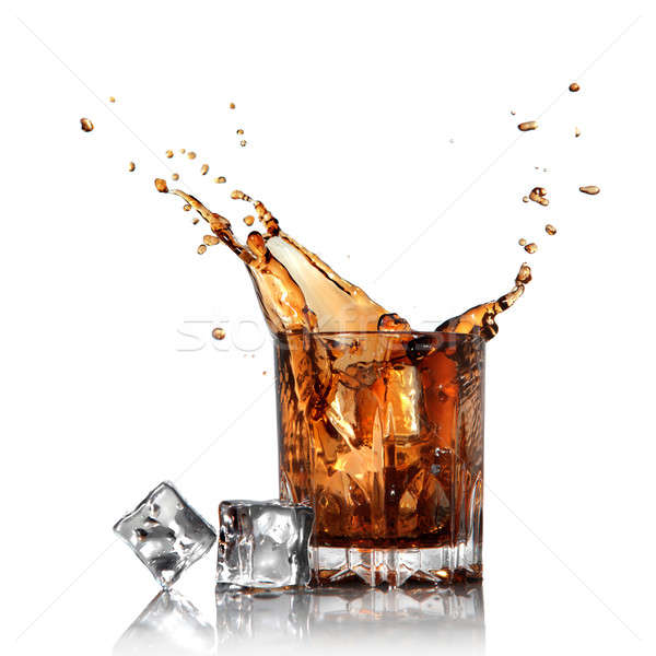 splash of cola in glass with ice cubes isolated on white Stock photo © artjazz