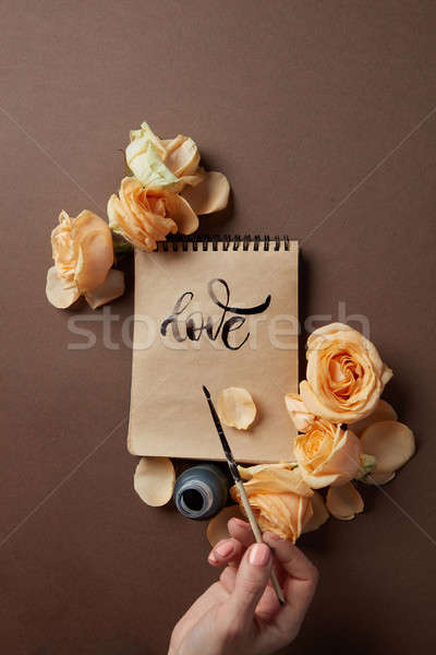 Hand with brush writing a love letter Stock photo © artjazz
