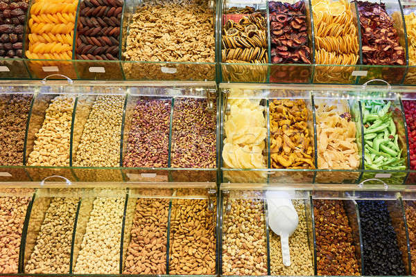 Market stall with various dried fruits and nuts Stock photo © artjazz