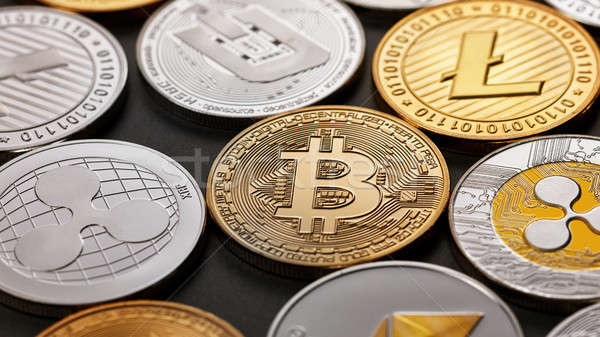 Set of a coin of crypto currency on a dark background. Business, finance and technology concept. Stock photo © artjazz