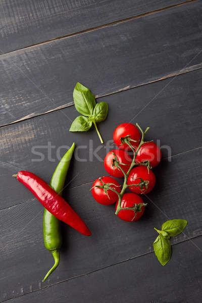 Italian food background with tomatoes, basil, and chili pepper o Stock photo © artjazz