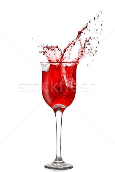 splash of red wine in goblet isolated on white Stock photo © artjazz