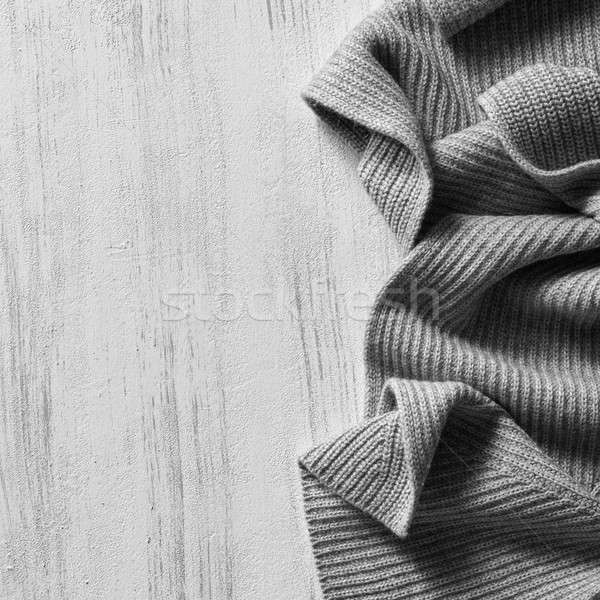 knitted sweater on old vintage wooden board Stock photo © artjazz