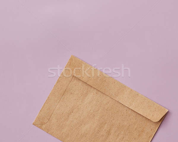 Brown craft envelope for mailing on pink background Stock photo © artjazz