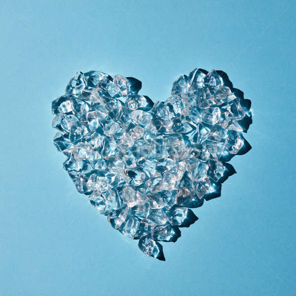Ice cubes in the shape of heart on a blue background. Flat lay Stock photo © artjazz