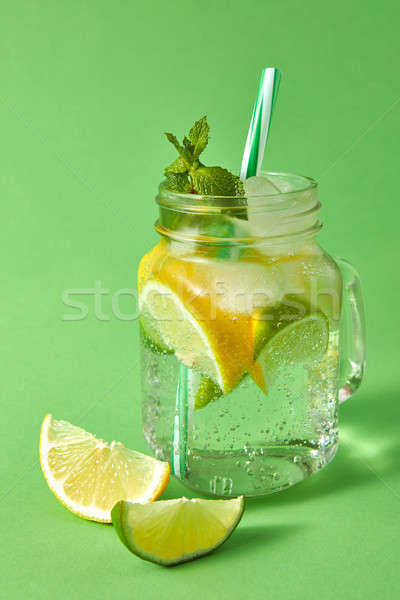 Stock photo: Homemade sparkling lemonade with ice, slices of lime and lemon,